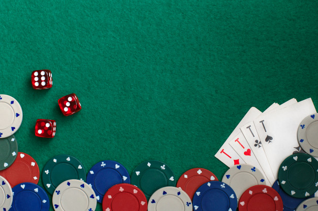 Premium Photo | Playing cards,dices and poker chips from above on green poker table